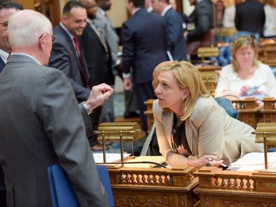 Assemblywoman Valerie Vainieri Huttle, D-Englewood, during a break at a legislative voting session last year.