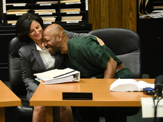 Vanessa Potkin, with the Innocence Project, hugs Eric Kelley after his murder conviction of Tito Merino in 1993 was overturned due to new DNA evidence on Sept. 15, 2017.