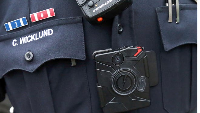Sgt. Chris Wicklund of the Burnsville Police Department wears a body camera beneath his microphone.