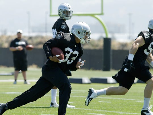 Oakland Raiders' safety Tyvon Branch (33) runs drills during an NFL football minicamp Monday, June 9, 2014, in Alameda, Calif. (AP Photo/Ben Margot)