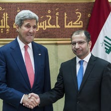 Salim al-Juburi (R), Speaker of the Iraqi Parliament shakes hands with US Secretary of State John Kerry before a meeting on September 10, 2014 in Baghdad. Kerry is visiting Iraq where he will meet with leaders, including new Prime Minister Haider al-Abadi, to talk about the threat presented by ISIS and other issues.