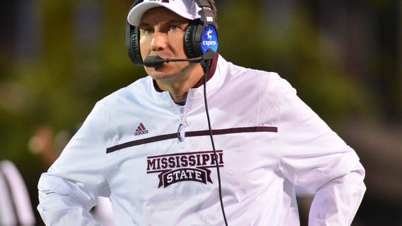 Sep 12, 2015; Starkville, MS, USA; Mississippi State Bulldogs head coach Dan Mullen talks into a headset during the 2nd quarter of the game against the LSU Tigers at Davis Wade Stadium. Mandatory Credit: Matt Bush-USA TODAY Sports