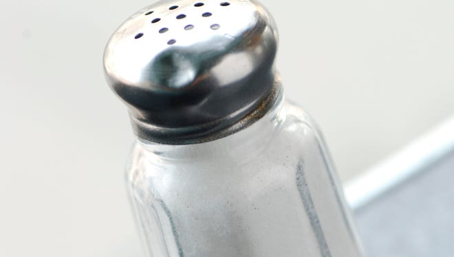 A new report says restaurants are still slow to cut down on sodium in their food.