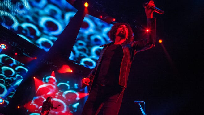 Mike Inez and William DuVall of Alice in Chains perform during the Rockstar Energy Drink Uproar Festival at the First Midwest Bank Amphitheatre in August 2013 in Tinley Park, Illinois.