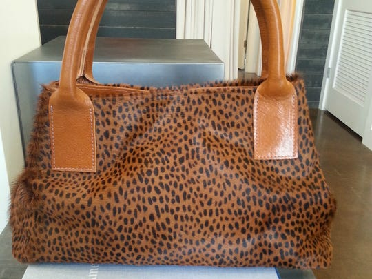 No leopards or ponies were harmed in the making of this dazzling leopard print pony hair satchel, although there might have been a cow involved. $495, Ceri Hoover, 2905 12th Ave. S., cerihoover.com; 615-200-0991.