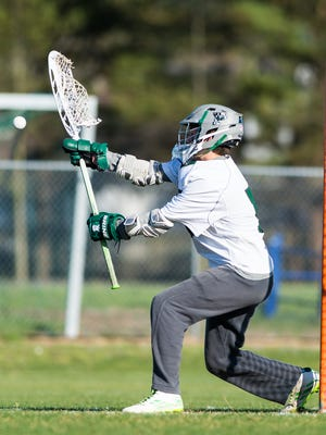 Parkside goalkeeper Phil Giarelli (5) makes a save against Saints Peter & Paul on Tuesday, March 29 at Parkside.