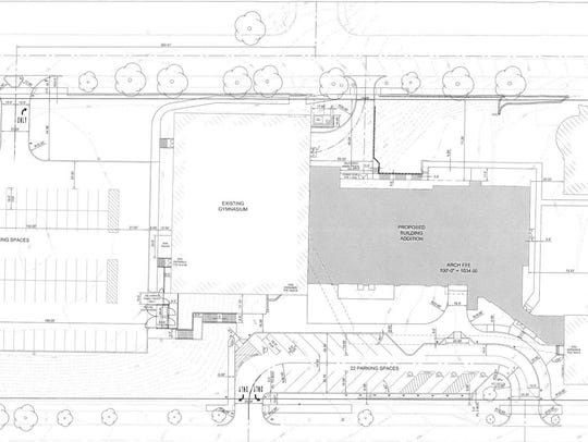 A site plan shows Cathedral High School's proposed