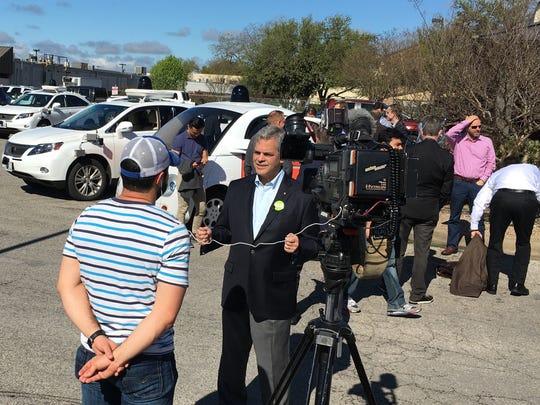 Austin mayor Steve Adler, center in jacket, was responsible