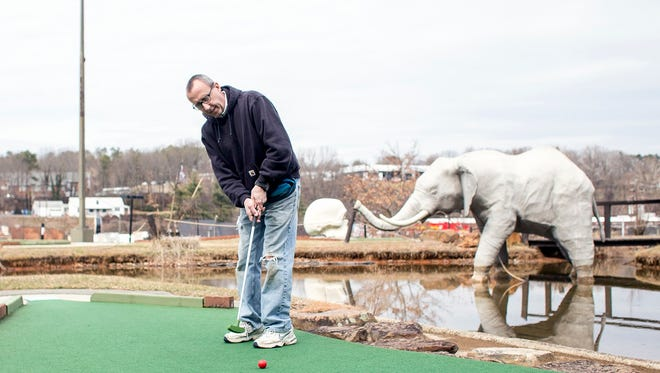 Mark Zimmerman, owner of Tropical Gardens Miniature Golf, puts on the course at the beginning of the season Monday.