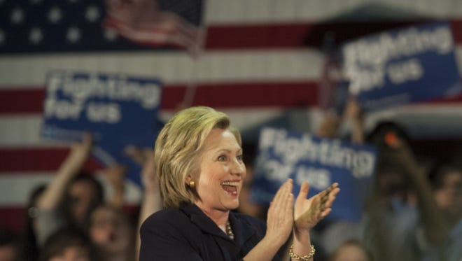 Hillary Clinton reacts to cheers from supporters during her campaign stop Wednesday at Camden County College in Blackwood.