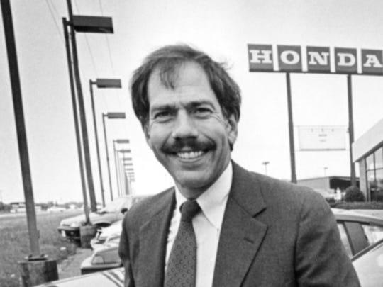 Warren Price is shown at his Price Honda dealership in 1986