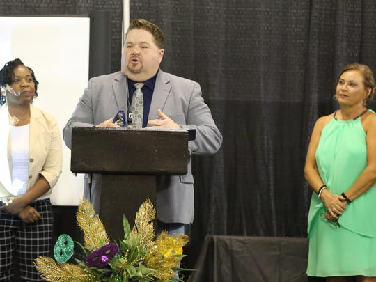 Gibson County Mayor Thomas Witherspoon accepts the REDI Regional Collaboration Award for Gibson County as Humboldt City Schools Superintendent Versie Hamlett looks on, Thursday evening at the Jackson Fairgrounds during the SWTDD Awards and Recognitions Banquet.