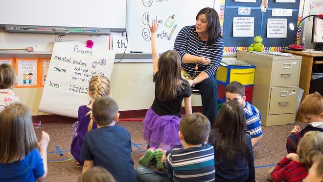 Kindergarten teacher Sheena Tillery asks her students questions at Fletcher Elementary School earlier this year. North Carolina teachers would get an average 3.3 percent raise during the coming fiscal year under a legislative budget plan.