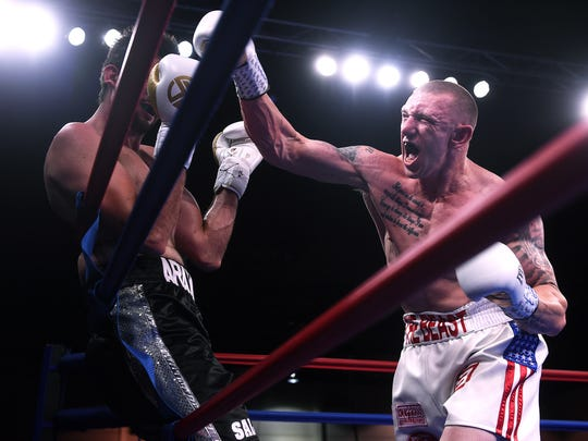 U.S. Army Veteran Blake  McKernan, right, attacks Mexico's