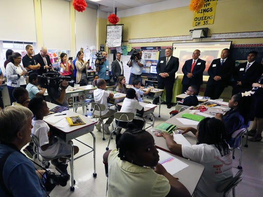 Linden Police Officer Angel Padilla who was shot Monday by alleged bombing suspect Ahmad Khan Rahami on Monday as he visits with Linden School # 5 school children who are making him get well cards on Thursday September 22, 2016.