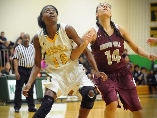 Mardela's Kayla Cook and Snow Hill's Michelle Dix battle