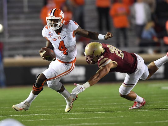 Clemson quarterback Deshaun Watson (4) eludes a tackle during the fourth quarter at Boston College's Alumni Stadium in Chestnut Hill, Massachusetts, on Oct. 7.
