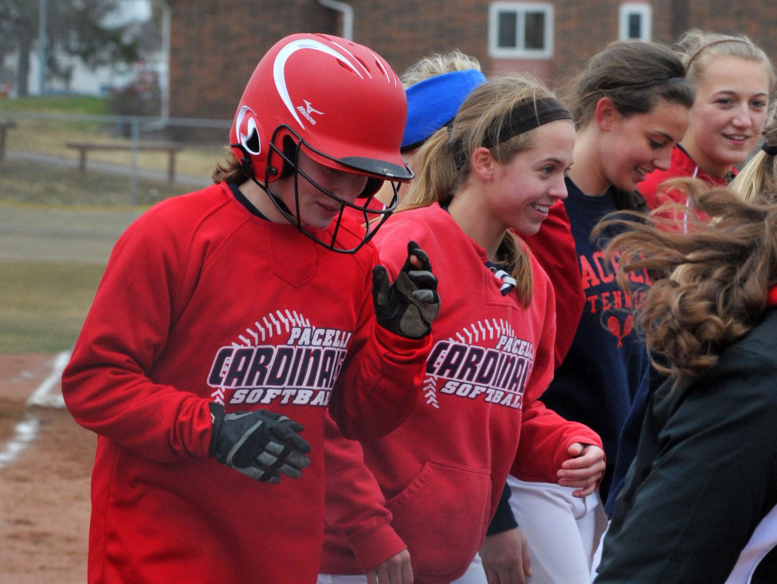 Pacelli's Sara Mitch, left, is greeted by teammates after hitting a two-run home run in the second inning.