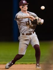 Mississippi State second baseman Hunter Stovall (13) throws a ball to first base against Jackson State during their game Wednesday night in Jackson.