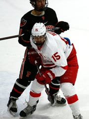 Trevor Yates tries to gain position against a Princeton