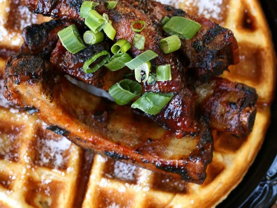 A Belgian waffle is topped with smoked ribs at Joe's