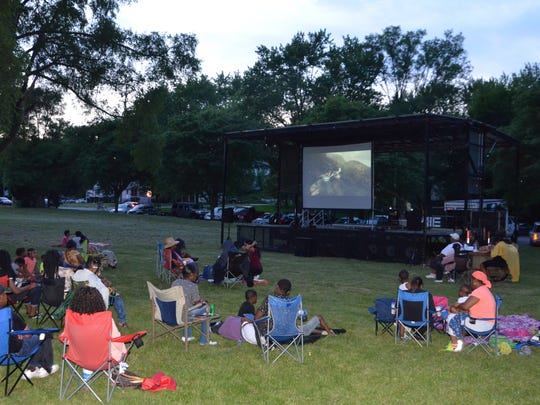 People gather at Claude Evans Park to watch a screening