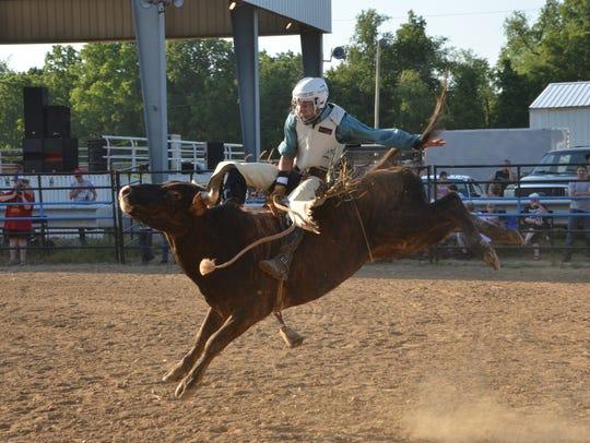 Bryce Bukowski rides a bull during an amateur bull