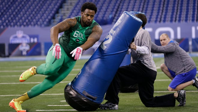 Auburn defensive lineman Angelo Blackson runs a drill at the NFL football scouting combine in Indianapolis in February. Blackson was expected to go later in the draft, but he showed excellent speed and agility during combine testing.