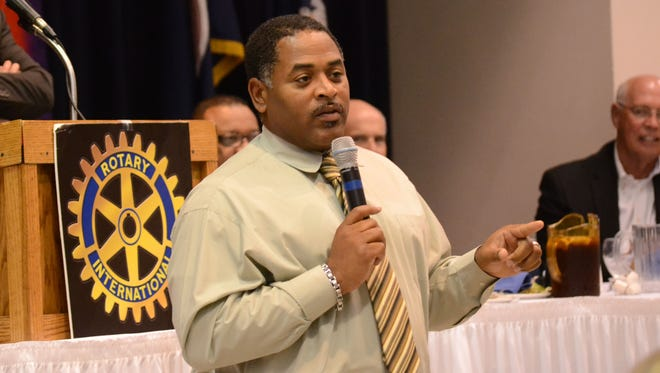 Recently hired Peabody Magnet High School football coach Toriano Williams speaks at the Annual Pigskin Preview at the Downtown Alexandria Rotary Club meeting on Tuesday.