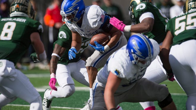 Air Force fullback Taven Birdow(23) breaks through the Rams defensive line during a game against CSU at CSU Stadium in Fort Collins, Colorado on Saturday, October 28, 2017.