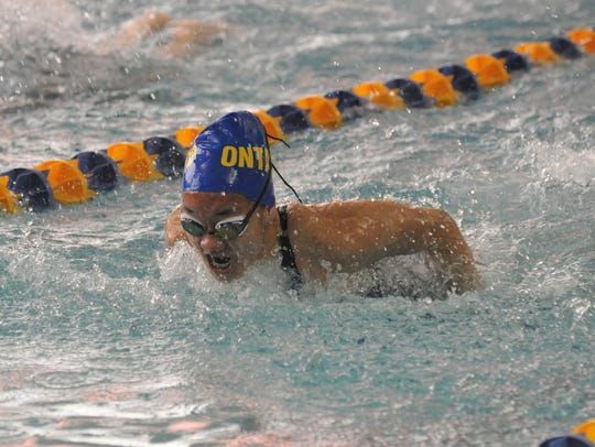 Ontario's Amy Evans swims the 100 butterfly.