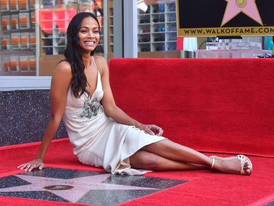 Actress Zoe Saldana poses at her Hollywood Walk of