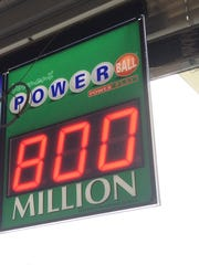 Mid-day allure: An $800 million Powerball jackpot is displayed Saturday morning at the Shelburne Citgo Jiffy Mart.
