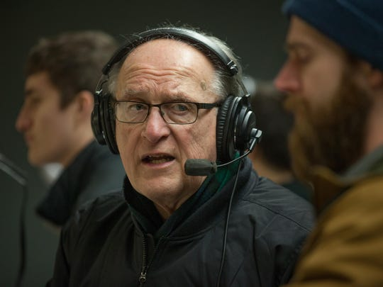 George Commo, the voice of Vermont ice hockey, calls a high school boys hockey game at the Cairns Arena in South Burlington.