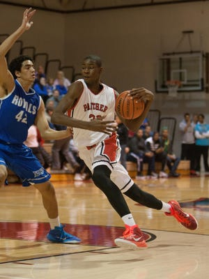 Park Tudor's Jaren Jackson Jr. drives against HSE's Zach Gunn at Park Tudor, Dec. 22, 2014. Park Tudor won 48-38.