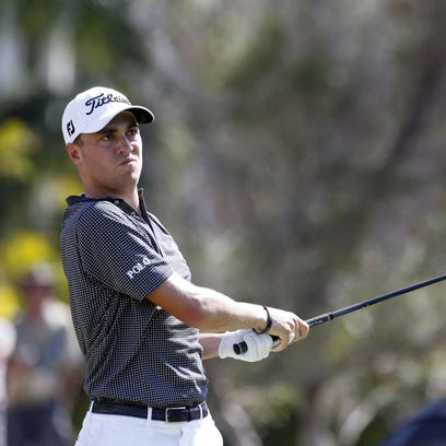PGA golfer Justin Thomas tees off on the first hole