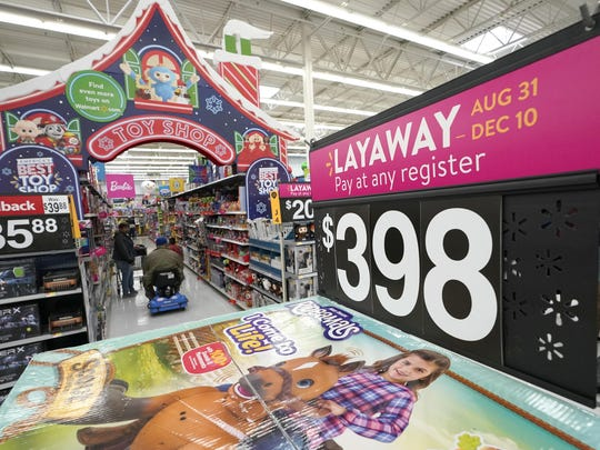 In this Friday, Nov. 9, 2018, photo toys are displayed at a Walmart Supercenter in Houston. The world's largest retailer delivered strong third-quarter results Thursday, Nov. 15, extending a streak of sales growth into its 11th straight quarter that showed it's pulling shoppers online and in the store. It also raised profit expectations for the year heading into the holiday shopping season.