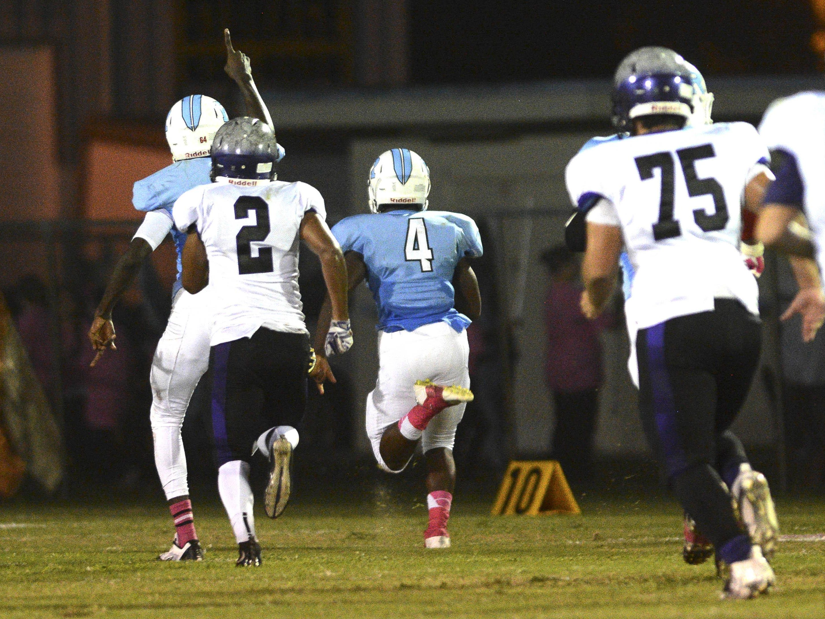 Rockledge's LaQuentin Hastie takes a recovered fumble all the way to the end zone during Friday's game at McLarty Stadium.