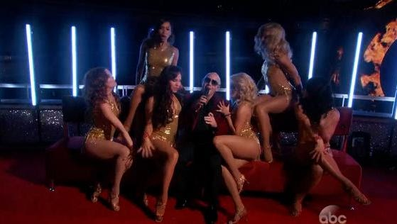 Pitbull and his bevy of beauties.