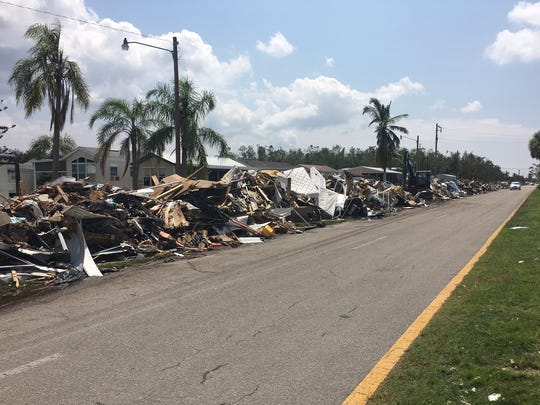A continuous pile of household debris lines Copeland Avenue in Everglades City on Sept. 26,, 2017.