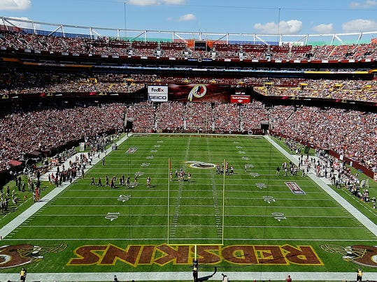 """FILE - In this Sept. 24, 2012, file photo, the Washington Redskins and Cincinnati Bengals face off during the first half of an NFL football game in Landover, Md. The U.S. Patent Office ruled Wednesday, June 18, 2014, that the Washington Redskins nickname is """"disparaging of Native Americans"""" and that the team's federal trademarks for the name must be canceled. The ruling comes after a campaign to change the name has gained momentum over the past year. (AP Photo/Alex Brandon, File)"""