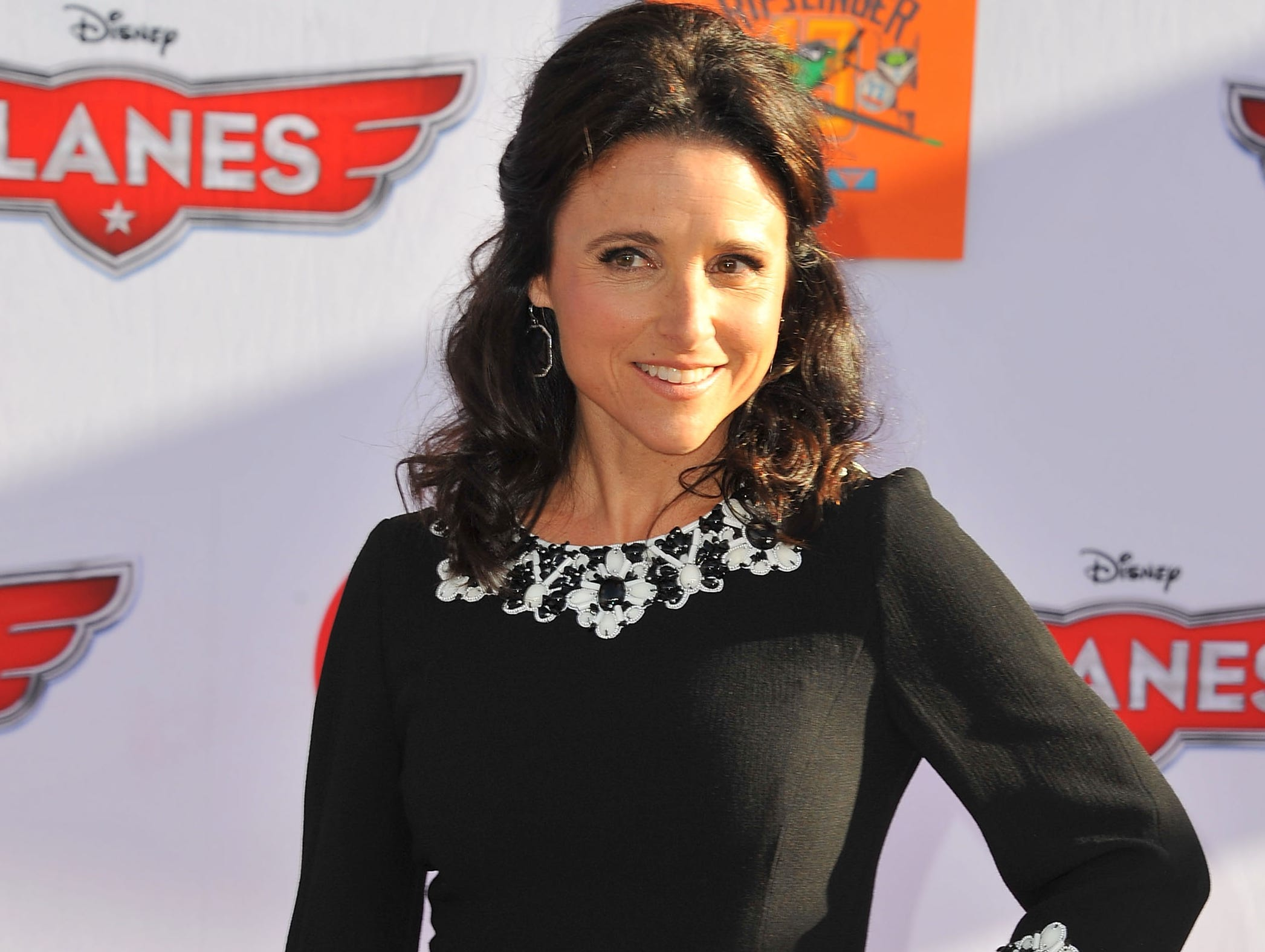 Julia Louis-Dreyfus is picture-perfect at the premiere of Disney's 'Planes' on Aug. 5 in an Andrew Gn frock and an Edie Parker clutch.