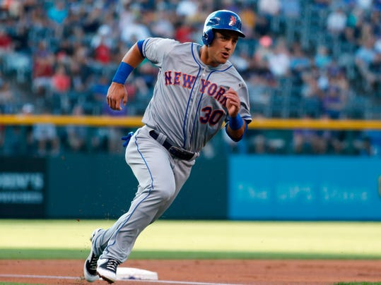 """FILE - In this Aug 1, 2017, file photo, New York Mets' Michael Conforto rounds third base to score on a double by Yoenis Cespedes off Colorado Rockies starting pitcher Jeff Hoffman during the first inning of a baseball game in Denver. Mets manager Mickey Callaway said Conforto could come off the disabled list this week in Washington. New York begins a three-game series against the NL East rival Nationals on Thursday, the first day Conforto is eligible to be activated. """"He's in a really good spot,"""" Callaway said. """"He's getting really close. I think you guys will probably see him very soon."""" (AP Photo/David Zalubowski)"""