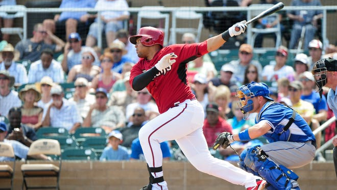 Arizona Diamondbacks third baseman Yasmany Tomas (24) singles in the first inning against the Los Angeles Dodgers at Salt River Fields at Talking Stick on March 30, 2015.