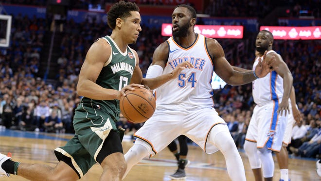 Milwaukee Bucks guard Malcolm Brogdon (13) drives to the basket in front of Oklahoma City Thunder forward Patrick Patterson (54) during the second quarter at Chesapeake Energy Arena.