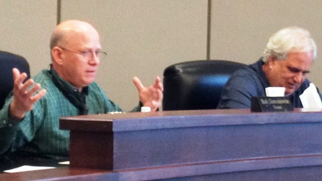 Trustee Bob Doroshewitz (left) next to Treasurer Ron Edwards, makes a point at Saturday's special meeting.