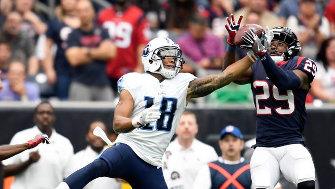 Texans safety Andre Hal (29) intercepts a pass intended for Titans wide receiver Rishard Matthews (18) during the second quarter Sunday, Oct. 1, 2017, at NRG Stadium.