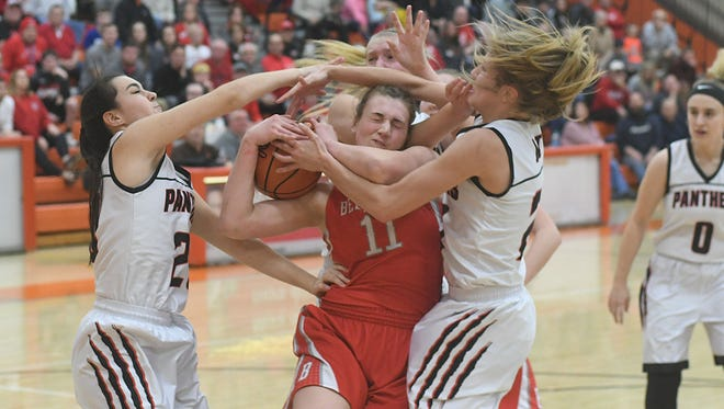 Bellevue's Payton Vogel tries to keep the ball away from a gang of Norton defenders on Tuesday night at Mansfield Senior High School.