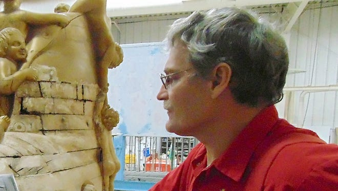 """ADVANCE FOR USE SATURDAY, FEB. 7 - In this photo taken Jan. 21, 2015, Harold """"Heavy"""" Burdick, wagon superintendent at Circus World Museum in Baraboo, Wis., says archival materials will guide restoration work on the 1882 Old Woman in a Shoe float. The museum recently launched an Adopt a Wagon program to raise money for restoration of its unparalleled collection of circus wagons. For $200 to $1,000, donors can help fix up wagons of their choice. (AP Photo/Baraboo News Republic,  Ben Bromley)"""