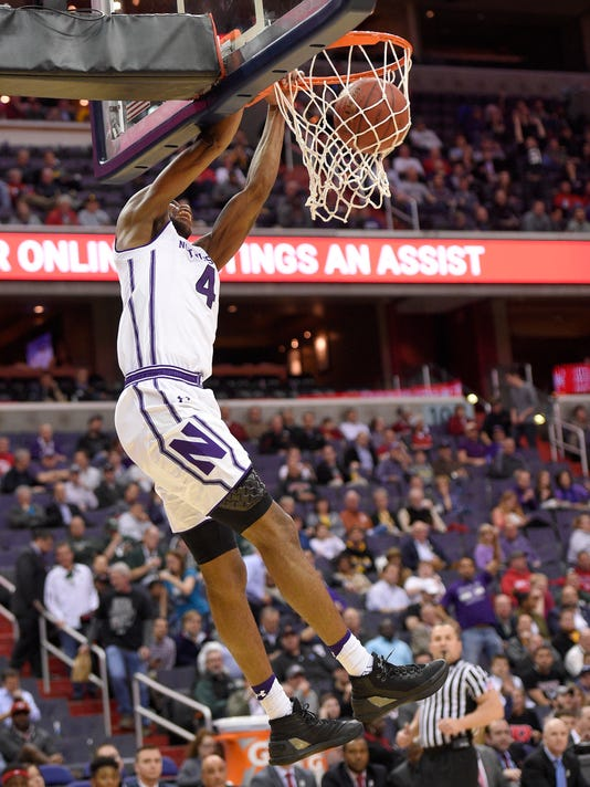 Northwestern forward Vic Law (4) dunks during the first half of an NCAA college basketball game in the Big Ten tournament against Rutgers, Thursday, March 9, 2017, in Washington. (AP Photo/Nick Wass)